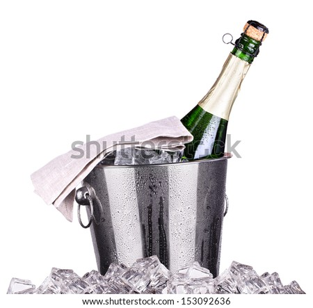 Champagne bottle in a bucket with ice on the white - stock photo