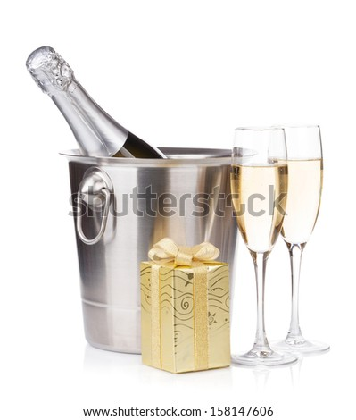 Champagne bottle in bucket, glasses and gift box. Isolated on white background - stock photo