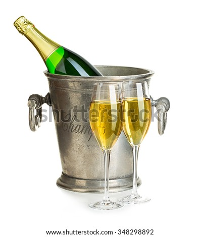 Champagne bottle in ice bucket with glasses of champagne close-up isolated on a white background. Festive still life. - stock photo