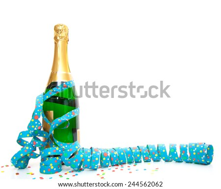 Champagne bottle with party utensils - stock photo