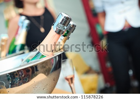 champagne bottles in ice cooler - stock photo