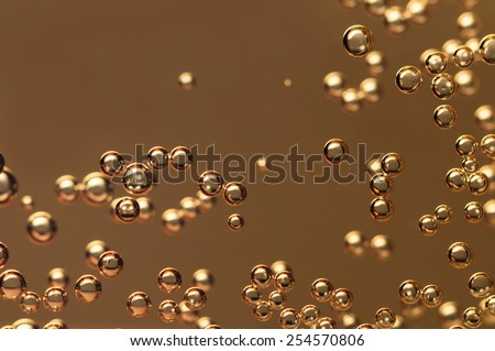 Champagne bubbles floating in a crystal glass - stock photo