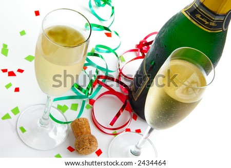 Champagne  classes, bottle and cork with colorful party ribbons