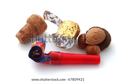 Champagne cork, foil, blower and nuts on a plain white background. - stock photo