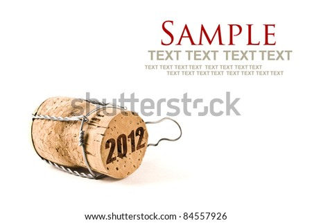 champagne cork isolated on white selective focus with text 2012
