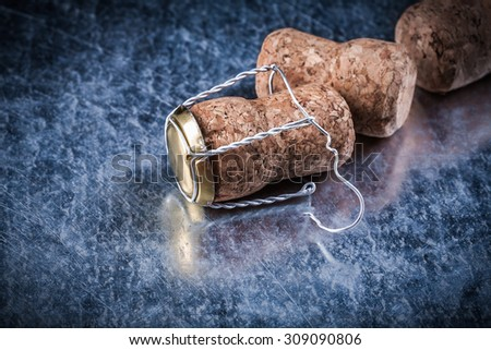 Champagne cork taps twisted wire on metallic background alcohol concept. - stock photo