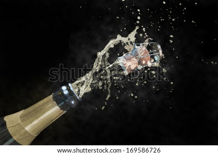 Champagne explosion, isolated on a black background