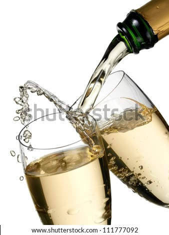 Champagne flow and up in two glasses - stock photo