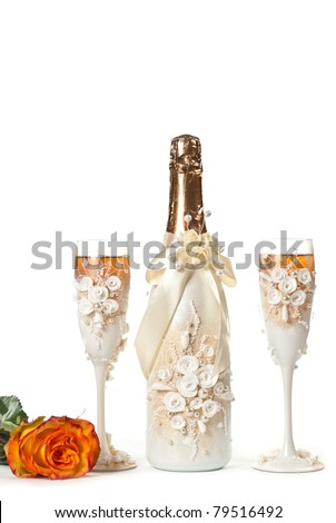 Champagne, flowers and two white glasses isolated on white - stock photo