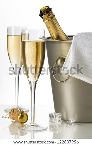 Champagne flutes and ice bucket in a close-up image - stock photo