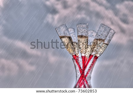 Champagne Flutes in the Rain - stock photo