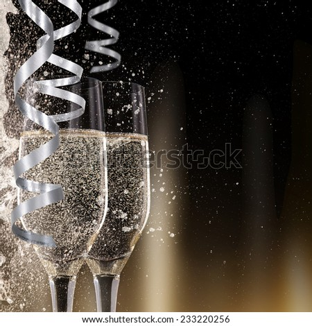 Champagne flutes on black background, celebration theme. - stock photo