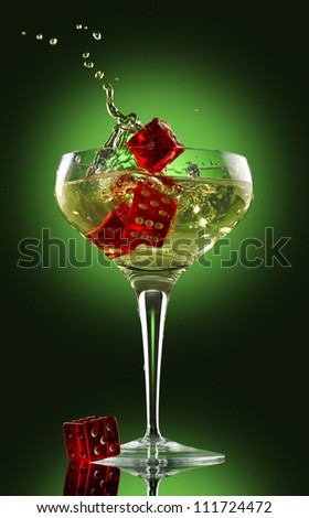 champagne glass alcohol splash party dice green - stock photo