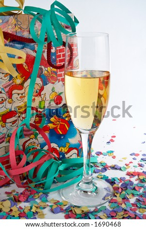 Champagne glass with shopping bag, ribbons and confetti