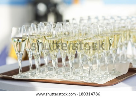 Champagne glasses being served on a party - stock photo