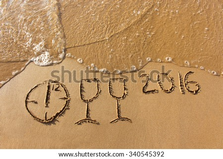 champagne glasses, clock which shows 12 hours, 2016 year written on sandy beach sea  - stock photo