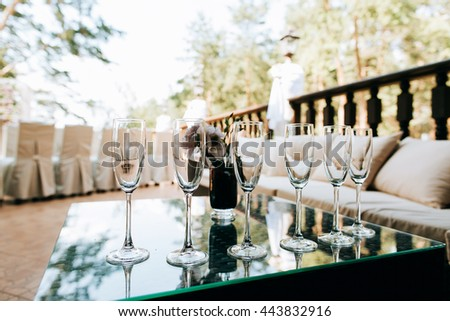 Champagne glasses closeup, Wedding reception alcohol  drink table. Alcohol background. - stock photo