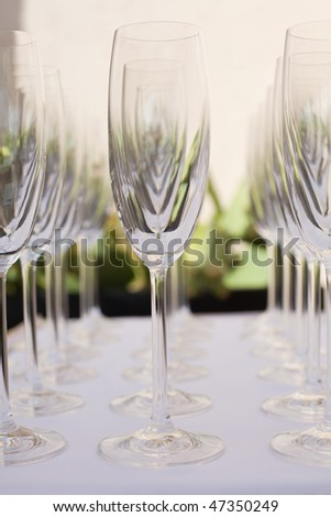 Champagne glasses on a table. - stock photo