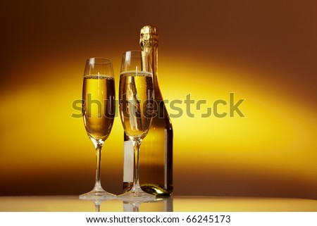 Champagne glasses on celebration table - stock photo