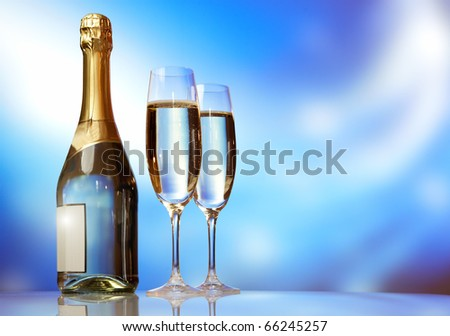 Champagne glasses on celebration table - stock photo