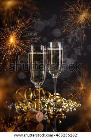 Champagne glasses on festive sparkler background