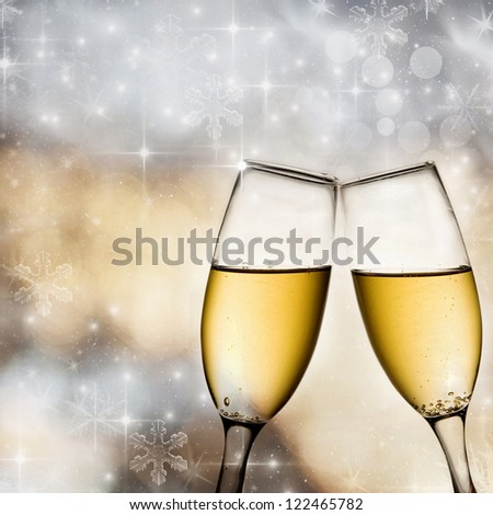 Champagne glasses on light bokeh background