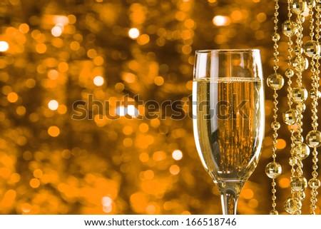 Champagne glasses on light bokeh background - stock photo