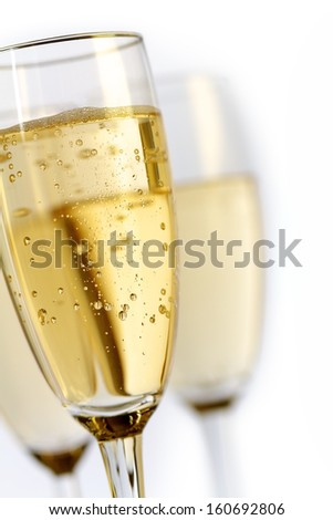 champagne glasses on white background. - stock photo
