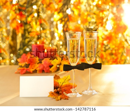 Champagne glasses with conceptual gay decoration  - stock photo