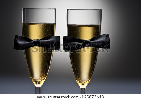 Champagne glasses with conceptual same sex decoration for gay men