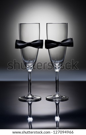 Champagne glasses with conceptual same sex decoration for gay men - stock photo