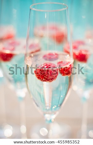 Champagne in glass ready to serve in party pool - stock photo