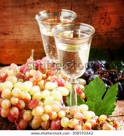 Champagne in glasses and fresh grapes, still life, selective focus - stock photo