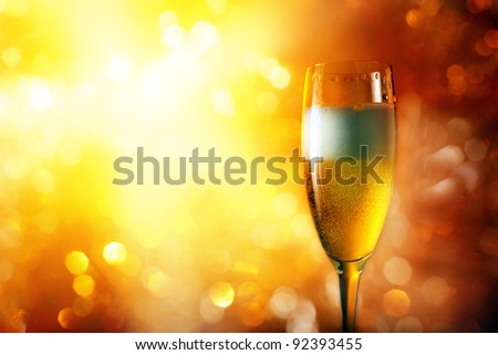 champagne in wineglass on a bright background.