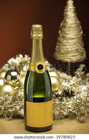 champagne on a table with christmas decorations - stock photo