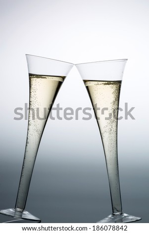 champagne or sparkling wine in a champagne glass. symbolic photo for celebrations, new year and good mood - stock photo