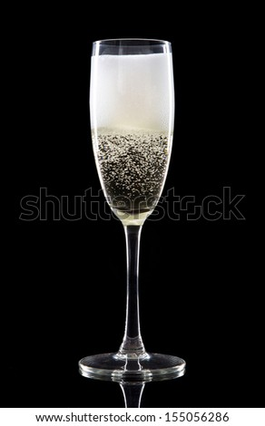 Champagne over black background. Celebration theme.