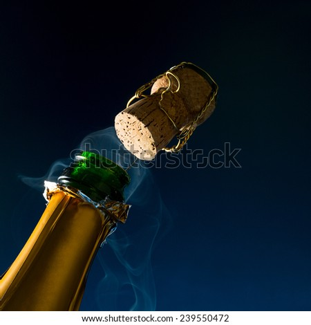 champagne popping with steam - stock photo