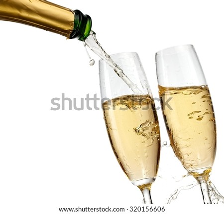 Champagne pour in two glasses - stock photo