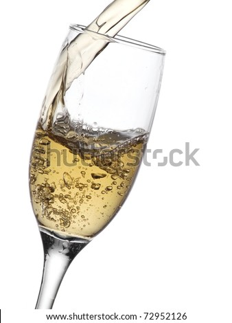 Champagne pouring into a glass