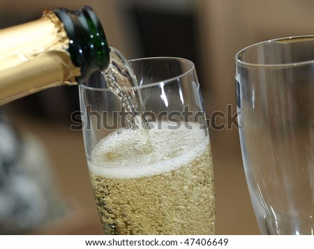 Champagne pouring into the glass - stock photo
