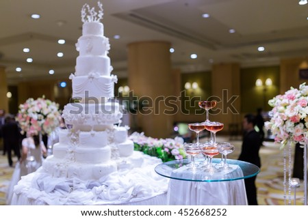 Champagne tower and in wedding cake. - stock photo