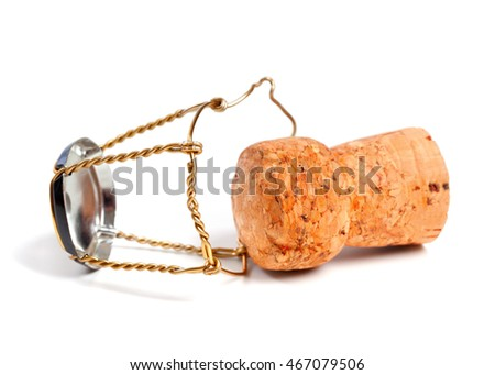Champagne wine cork and muselet isolated on white background. Selective focus.