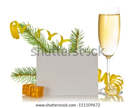 Champagne wine glass, pine branch with a serpentine, small gift boxes and the empty card isolated on white