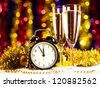 champagne with clock on blurred background - stock photo
