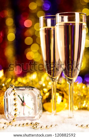 champagne with clock on blurred background