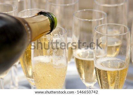 Champaign. Champaign being pored into glasses. - stock photo
