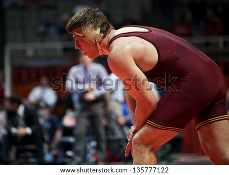 CHAMPAIGN, IL -MARCH 10: Minnesota's Tony Nelson wrestles to a win over Northwestern's Mike McMullen in the Big Ten Wrestling Championships in Assembly Hall March 10, 2013 in Champaign, IL.
