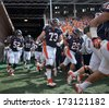 CHAMPAIGN,IL-SEPTEMBER 28: Illini football team members take the field before a game against Miami-OH on Saturday, Sept 28, 2013. - stock