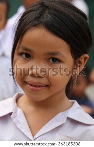 CHAMPASAK, LAOS, November 21, 2012 : A young pupil poses for a portrait in the school courtyard.